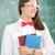 okos · iskolás · lány · tart · tankönyvek · osztályterem · háttér - stock fotó © zurijeta