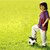 happy kid playing football in a park outdoors stock photo © zurijeta