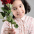 cute girl with a beautiful red rose in her hands stock photo © zurijeta