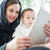 happy arabic family having fun time mom and baby using gadget stock photo © zurijeta