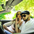 beautiful couple in a sports car outdoors stock photo © zurijeta