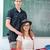 schoolgirl sitting on teachers desk stock photo © zurijeta