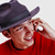 young man with red shirt and black hat speaking on phone stock photo © zurijeta