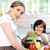 beautiful mother and little son in kitchen together stock photo © zurijeta
