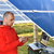 engineer working with laptop by solar panels talking on cell phone stock photo © zurijeta