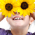 happy little girl with sunflowers on eyes stock photo © zurijeta