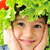 closeup image of a little kid with tomato and salad hat on his head stock photo © zurijeta