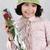 cute little girl holding red rose stock photo © zurijeta