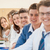 gelukkig · groep · studenten · poseren · vergadering · samen - stockfoto © zurijeta