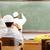 teacher at classroom writing ramadan on board stock photo © zurijeta