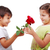 very cute scene of two little children with rose stock photo © zurijeta