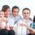 feliz · pais · crianças · posando · três · bebê - foto stock © zurijeta