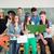 csoport · diákok · pózol · iskolatábla · lány · háttér - stock fotó © zurijeta