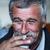 common elderly man with mustache smoking cigarette and drinking coffee stock photo © zurijeta