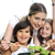 beautiful mother with little son and daugther in kitchen together stock photo © zurijeta