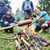 barbecue in nature group of people preparing sausages on fire note selected focus stock photo © zurijeta