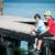 girld and boy on lake dock in italy stock photo © zurijeta