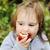 прелестный · ребенка · девушки · еды · красное · яблоко · за · пределами - Сток-фото © zurijeta