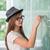 schoolgirl writing on chalkboard stock photo © zurijeta