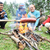 barbecue in nature group of people preparing sausages on fire note shallow dof stock photo © zurijeta