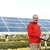 Engineer using laptop, solar panels in background stock photo © zurijeta