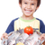 smiling kid with three fresh fishes on table stock photo © zurijeta