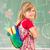 cute little school blonde girl in school classroom on board posi stock photo © zurijeta
