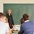 leraar · Blackboard · permanente · naar · studenten · vrouw - stockfoto © zurijeta