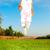 gelukkig · meisje · springen · weide · hemel · bloemen - stockfoto © zurijeta
