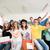 csoport · mosolyog · osztálytársak · ül · zöld · tábla - stock fotó © zurijeta