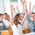 smiling students holding hands in the air stock photo © zurijeta